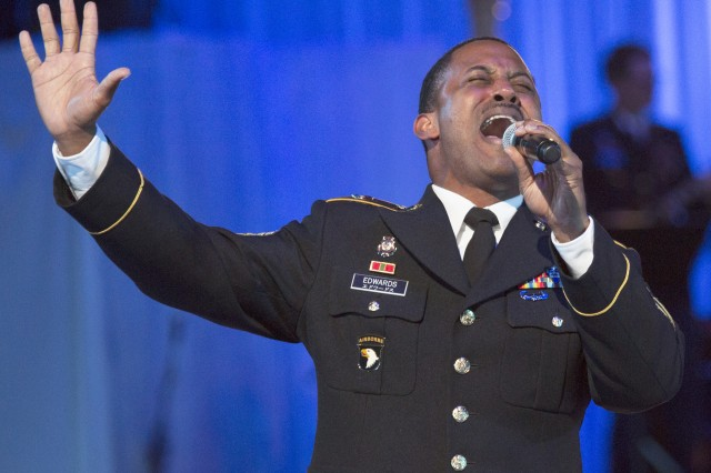 "Staff Sgt. Dnard Edwards sings ""Eye of the Tiger"" from ""Rocky III"" during the U.S. Army Japan Band's performance at the 54th annual Japan Self-Defense Forces Marching Festival, held Nov. 21 through 23 at the famed Budokan arena in Tokyo."