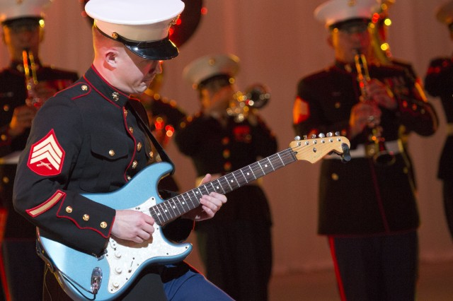A member of the III Marine Expeditionary Force Band plays guitar during the U.S. Army Japan Band's performance at the 54th annual Japan Self-Defense Forces Marching Festival, held Nov. 21 through 23 at the famed Budokan arena in Tokyo.