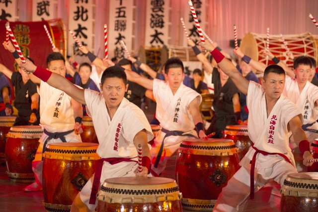 Taiko drummers give a thunderous, synchronized performance to a crowd of thousands Nov. 21 during the 54th annual Japan Self-Defense Forces Marching Festival at the Nippon Budokan arena in Tokyo.