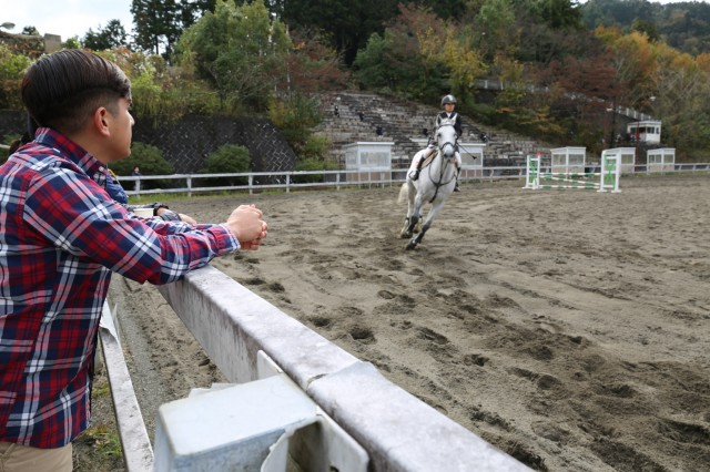 Staff Sgt. Karim Acosta, assigned to U.S. Army Medical Activity - Japan, watches the 70th annual BG Sams Equestrian Cup on Nov. 18, 2018, at Tsukui Equestrian Park.