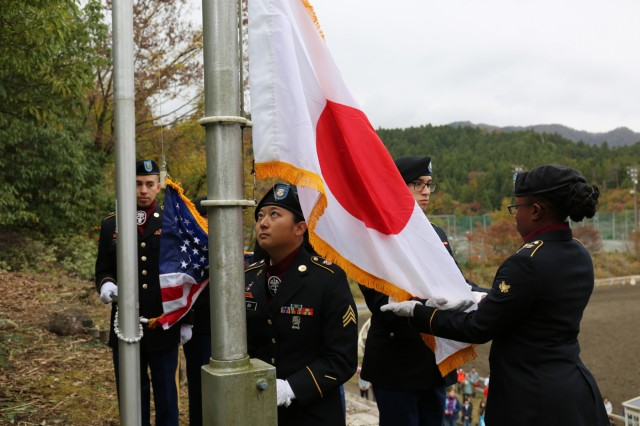 Soldiers assigned to U.S. Army Medical Activity - Japan raise the Japanese and U.S. flags before the 70th annual BG Sams Equestrian Cup opening ceremony Nov. 18, 2018, at Tsukui Equestrian Park.