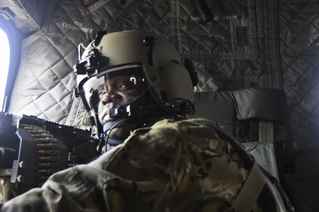 Command Sgt. Maj. Reginald Thomas, Destiny 7, prepares to send rounds down range during gunnery operations at Bagram Airfield, Afghanistan No. 5, 2018.
