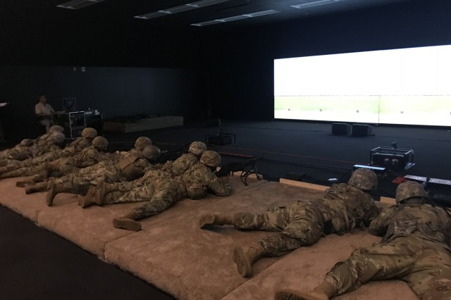 SCHOFIELD BARRACKS, Hawaii - Soldiers engage targets on a video screen during the Engagement Skills Trainer course at Schofield Barracks, Hawaii, during Operation Pacific Steel, Oct. 12, 2018.