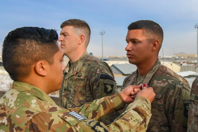 U.S. Army Soldiers assigned to Task Force Destiny receive awards at Bagram Airfield, Afghanistan Nov. 21, 2018. The Soldiers were awarded Good Conduct Medals for their time in service and impact awards for their outstanding work and dedication.