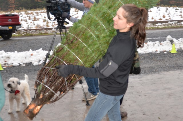 New York Air National Guard Staff Sgt. Shannon Schiller, assigned to the 109th Airlift Wing in Scotia, N.Y., helps load donated Christmas trees at Ellms Tree Farm in Ballston Spa, N.Y., November 26, 2018. Nearly 20 volunteers turned out to help load 130 Christmas Trees bound for military families at Fort Bragg, N.C. The effort supported Trees for Troops, a nationwide campaign of the Christmas Spirit Foundation to deliver donated trees to military personnel and their families across the country and around the globe.