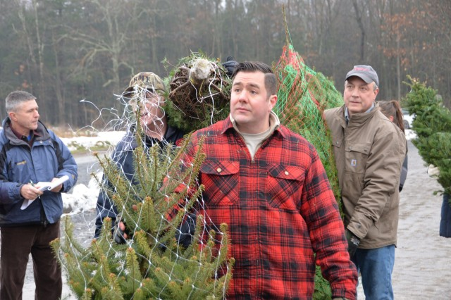 New York Air National Guard Master Sgt. Kyle Defeo, assigned to the 109th Airlift Wing in Scotia, N.Y., helps load donated Christmas trees at Ellms Tree Farm in Ballston Spa, N.Y., November 26, 2018. Nearly 20 volunteers turned out to help load 130 Christmas Trees bound for military families at Fort Bragg, N.C. The effort supported Trees for Troops, a nationwide campaign of the Christmas Spirit Foundation to deliver donated trees to military personnel and their families across the country and around the globe.