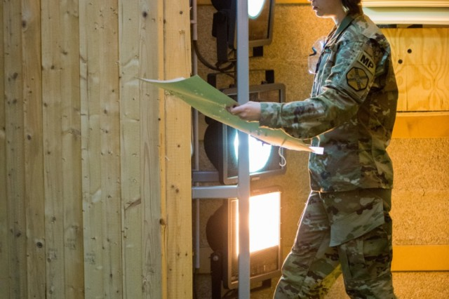 U.S. Army Spc. Scarlett Mitchell, with United States Army Garrison Benelux, verifies that she successfully qualifies with her new M4A1 carbine in the Training Support Center Benelux 25-meter indoor range, in Chièvres, Belgium, Aug. 24, 2016.