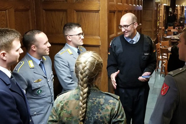 Army War College's international fellow German Col. Axel Hardt chats with West Point cadets from Germany after having lunch together in Washington Hall during their visit to USMA, Oct 16.