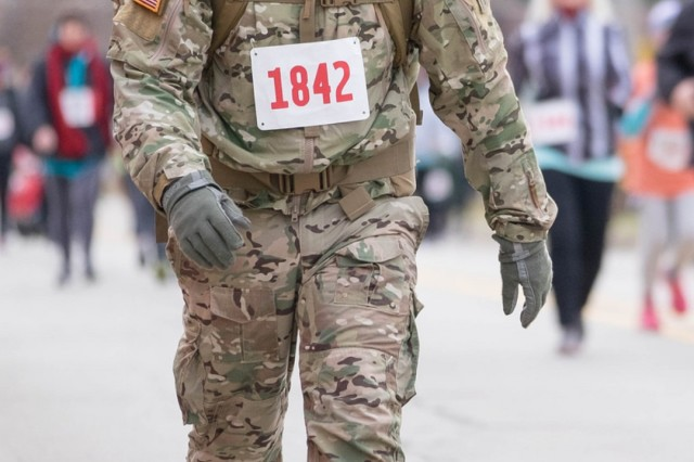 "Sgt. 1st Class John Garrett walks the ""Galloping Gobbler"" road race in Fort Wayne, Ind., Nov. 24, 2018, with the temperature just above 20 degrees Fahrenheit. The full-time Soldier with the Indiana National Guard's 1st Battalion of the 293rd Infantry participates in road races to draw attention to veterans' issues."