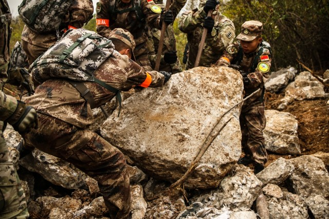 U.S. Army and PRC PLA Soldiers work together to move debris during the practical field exchange of the 2018 Disaster Management Exchange, Nov. 13 to 18, 2018, in Nanjing, China. The DME is an annual USARPAC and PLA disaster risk reduction event, which underscores the commitment of both U.S. and the PRC to address Humanitarian Assistance and Disaster Relief challenges across the region. The 2018 DME focused on an international disaster relief scenario following a hypothetical devasting earthquake in a third country.