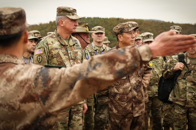 U.S. Army Gen. Robert Brown, U.S. Army Pacific commander and Lt. Gen. Qin Weijiang, PRC PLA's Eastern Theater Command deputy commander, tour the practical field exchange site of the Disaster Management Exchange in Nanjing, China, Nov. 17, 2018. The DME is an annual USARPAC and PLA disaster risk reduction event, which underscores the commitment of both U.S. and the PRC to address Humanitarian Assistance and Disaster Relief challenges across the region. The 2018 DME focused on an international disaster relief scenario following a hypothetical devastating earthquake in a third country.