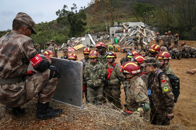 U.S. Army and PRC PLA Soldiers receive instructions for the day during the practical field exchange of the 2018 Disaster Management Exchange in Nanjing, China, Nov. 13 to Nov. 18, 2018. The DME is an annual USARPAC and PLA disaster risk reduction event, which underscores the commitment of both U.S. and the PRC to address Humanitarian Assistance and Disaster Relief challenges across the region. The 2018 DME focused on an international disaster relief scenario following a hypothetical devastating earthquake in a third country.