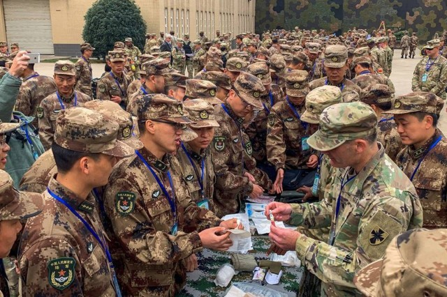 Army Lt. Col. Matthew Fargo, 8th Theater Sustainment Command, command surgeon, shows U.S. Army medical equipment to PLA Soldiers during the 2018 Disaster Management Exchange at Jurong Military Installation, China, Nov. 13 to Nov. 18, 2018. The DME is a key disaster risk reduction event that U.S. Army Pacific conducts with the PLA each year; the DME has matured from basic visits and briefings into a substantive exchange that uses table top and practical field exchanges to focus and facilitate disaster risk reduction and interaction between the USARPAC and the PLA.