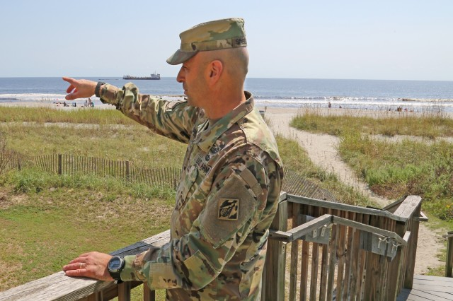 U.S. Army Corps of Engineers Deputy Commanding General for Civil and Emergency Operations, Maj. Gen. Scott Spellmon, points out beach renourishment operations to local government officials, USACE personnel and contractors along Myrtle Beach, S.C., following Hurricane Florence here, Sept. 22, 2018. These operations are designed to help rehabilitate shorelines to mitigate risk of storm-related damage to coastal communities and infrastructure. This project is part of rehabilitation efforts from previous hurricanes, but was put on hold due to Florence.