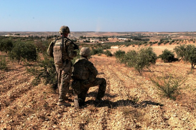 U.S. Soldiers observe Turkish forces in the distance during a patrol outside Manbij, Syria, Aug. 19, 2018. Turkish military forces conduct independent, coordinated patrols on their side of the demarcation line. The patrols provide security to the people of Manbij and help prevent the reemergence of ISIS in the area.