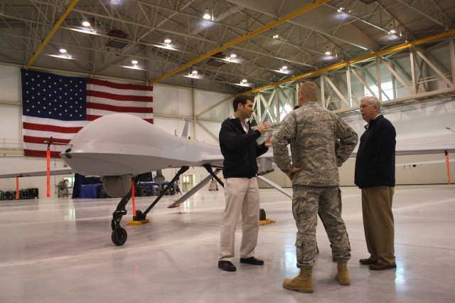 Singer at a U.S. Air Force facility, discussing new technology.
