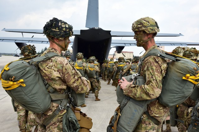 U.S. Army Col. James Bartholomees III (right), commander of the 173rd Airborne Brigade and Lt. Col. Jim D. Keirsey (left), commander of 2nd Battalion, 503rd Infantry Regiment, 173rd Airborne Brigade prepare to board a U.S. Air Force C-130 Hercules aircraft at Aviano Air Base in preparation for airborne operations onto Juliet Drope Zone in Pordenone, Italy April 10, 2018. The 173rd Airborne Brigade is the U.S. Army Contingency Response Force in Europe, capable of projecting ready forces anywhere in the U.S. European, Africa or Central Commands' areas of responsibility.