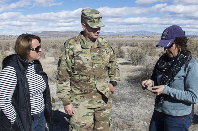 181106A-BB276-002 Col. Brant Hoskins, commander of Dugway Proving Ground, Utah, and his wife Janine, listen to archeologist Jennifer DeGraffenried (right) explain a small hearth stone. It was found during a cultural resources survey. Photo taken during the Nov. 6, 2018 Native American Indian Heritage Month Observance field trip and archaeological site visit. Photo by Al Vogel, Dugway Proving Ground Public Affairs