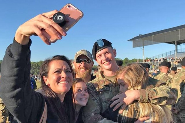 Family members take a selfie with their Soldier during a recent Family Day at Fort Jackson.