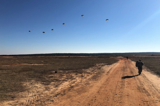 Airborne jump Mmasters and Soldiers jump from an aircraft during familiarization day, Nov. 28, 2018 at Fort Bragg, N.C. in preparation for U.S. Army Civil Affairs and Psychological Operations Command's 21st annual Operation Toy Drop. Operation Toy Drop is a combined airborne training event comprising airborne paratroopers from 14 partner nations. Each year, participating units and observers contribute toys that are distributed to various North Carolina charities.