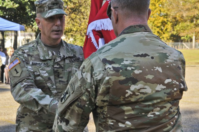 U.S. Army Reserve Maj. Gen. Daniel Christian, left, passes the 412th Theater Engineer Command (TEC) colors to Command Sgt. Maj. Dennis Law, senior enlisted advisor of the TEC, during a relinquishment of command ceremony at the George A. Morris U.S. Army Reserve Center in Vicksburg, Miss., Nov. 18, 2018.