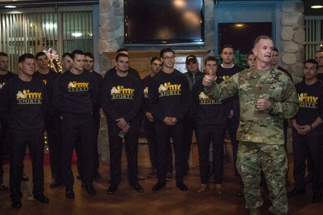 Maj. Gen. Walter E. Piatt, 10th Mountain Division (LI) and Fort Drum commander, welcome the Soldier-athletes who are trying out for this year's All Army Ice Hockey Team during an icebreaker social Nov. 29 at Fort Drum, New York. (U.S. Army photo by Spc. Charlotte Carulli, 27th Public Affairs Detachment)