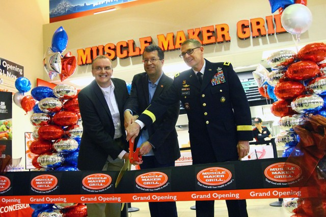 Fort Sill Exchange general manager Don Walter Jr.; Mike Roper, Muscle Maker Grill CEO; and Maj. Gen. Wilson A. Shoffner, Fires Center of Excellence and Fort Sill commanding general, cut the ribbon to open Muscle Maker Grill Nov. 21, 2018, at the Fort Sill Main Exchange food court.