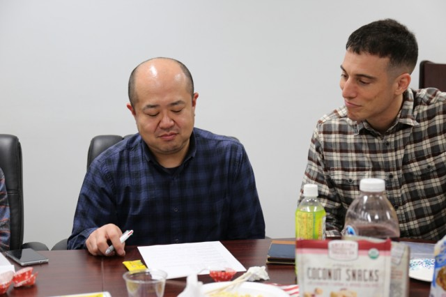 Major Gregory Costello, assigned to U.S. Army Japan Staff Judge Advocate, right, checks Tadayuki Matsumoto's notes during an Army Community Service's English as a Second Language class held Nov. 7, 2018, on Camp Zama, Japan.