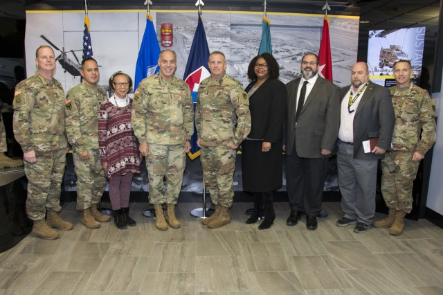 Gen. Gustave F. Perna, commanding general, U.S. Army Materiel Command, congratulates recipients of his commander's coin before his quarterly update meeting at the U.S. Army Sustainment Command, Rock Island Arsenal, Illinois, Nov. 29.