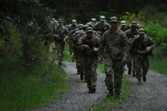 Competitors in the 2018 I Corps Best Warrior Competition conduct a 7-mile road march during the 2nd day of the competition on May 15, 2018, at Joint Base Lewis-McChord. All competitors were required to carry over 35 pounds in their ruck sack and complete the course as quickly as possible. (U.S. Army photo by Sgt. Kyle Larsen)