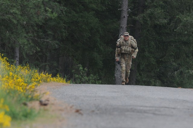1st Sgt. Justin Kline, a first sergeant representing 25th Infantry Division, finishes a 7-mile road march during the 2nd day of the competition on May 15, 2018, at Joint Base Lewis-McChord. All competitors were required to carry over 35 pounds in their ruck sack and complete the course as quickly as possible. (U.S. Army photo by Sgt. Kyle Larsen)