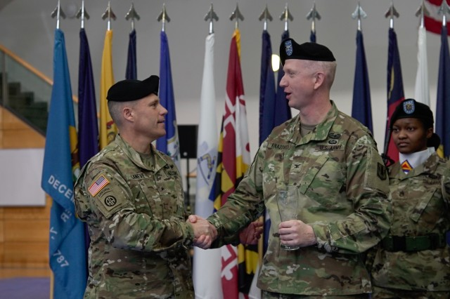 "U.S. Army Brig. Gen. Christopher LaNeve, left, commanding general of the 7th Army Training Command, presented the first gift for the 41st Field Artillery Brigade's display case to U.S. Army Col. Seth Knazovich, commander of the 41st Field Artillery Brigade, during the unit's activation ceremony in Grafenwoehr, Germany, Nov. 30, 2018. The 41st Field Artillery Bde. ""Railgunners"" is the new unit activating in Grafenwoehr, Germany under the training readiness authority of 7th Army Training Command and will provide long-range precision fires capabilities for U.S. Army Europe. (U.S. Army photo by U.S. Spc. Emily Houdershieldt)"