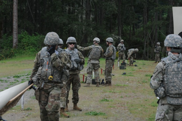 Safties prepare Range Three for an M-9 stress shoot for competitors in the 2018 I Corps Best Warrior Competition following a road march during the 2nd day of the competition on May 15, 2018, at Joint Base Lewis-McChord. All competitors fired the weapon between various physical excercises designed to tire their body and mind. (U.S. Army photo by Sgt. Kyle Larsen)