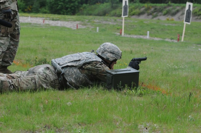 Staff Sgt. Steve Bok, 109th Battalion, 201st Expeditionary Military Intelligence Brigade, fires an M-9 during a stress shoot  in the 2018 I Corps Best Warrior Competition on May 15, 2018, at Joint Base Lewis-McChord. All competitors fired the weapon between various physical excercises designed to tire their body and mind. (U.S. Army photo by Sgt. Kyle Larsen)