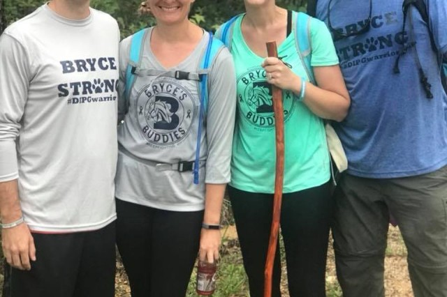 From left to right, Maj. Jeremy Caldwell, his wife, Suzy, and their friends Kate and Will Searcy participate in a hiking challenge to raise more than $42,000 for a non-profit foundation in memory of their son, who received a wish trip to visit the Denver Broncos headquarters in 2017. The couple were awarded the Lori Schultz-Betancourt Indomitable Spirit Award in October at the nonprofit's annual conference in Phoenix.