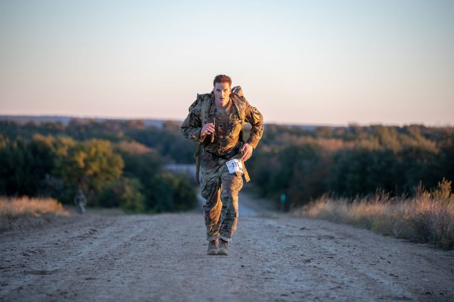 More than 200 Soldiers from the 1st Cavalry Division stepped off on a 18.64 mile ruck march at 5 a.m. in honor of Chaplain Emil Kapaun, an Army chaplain who was forced to march 87 miles to a prisoner of war camp during the Korean war in 1950. The annual event, organized by Maj. Jason Palmer, assistant 1st Cavalry Division chaplain, memorializes Chaplain Kapaun and highlights the selfless service and honor of First Team Soldiers. Remembering those who came before us.