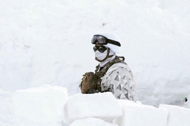 A student of the Chilean Mountain Warfare School stands in the snow during the winter portion of the course in the Chilean Andes mountains.