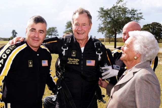 Former President George H.W. Bush celebrates following a parachute jump for the 10th anniversary and rededication ceremonies of the George Bush Presidential Library and Museum in College Station, Texas, Nov. 10, 2007.