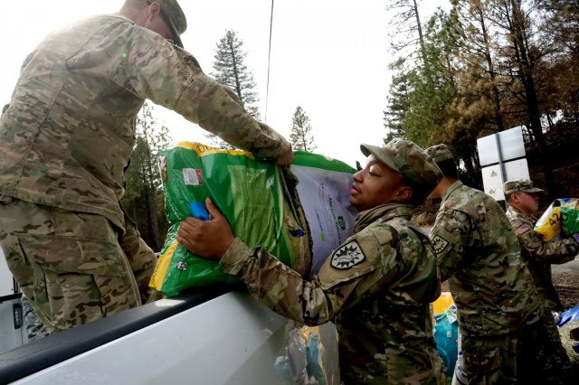 Soldiers from the California Army National Guard's 2632nd Transportation Company unload donated supplies at a cache point in Oroville, California, Nov. 26, 2018. The 2632nd transported critical supplies across the Butte County area to help residents impacted by the deadly Camp Fire.