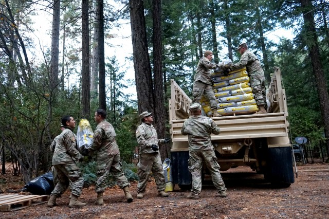 Soldiers from the California Army National Guard's 2632nd Transportation Company unload donated supplies at a residential distribution center in Magalia, California, Nov. 26, 2018. The 2632nd transported critical supplies across the Butte County area to help residents impacted by the deadly Camp Fire.