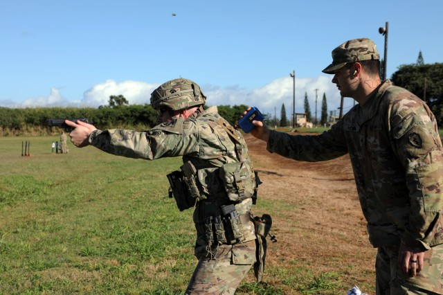 Day two of America's First Corps' 2-Gun Sharpshooter Competition hosted by 25th Infantry Division at Schofield Barracks, Hawaii begins with the shoot-no shoot event. Competitors have six seconds to engage targets identified as enemy, and must avoid any friendly element.