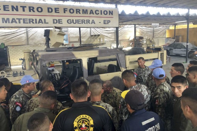 West Virginia Army National Guard (WVARNG) Master Sgt. Ricky Baker discusses preventative maintenance checks and services of the M1165 HMMWV Nov. 28, 2018, with Peruvian army maintenance personnel during a Subject Matter Expert Exchange (SMEE) Global Peace Operations Initiative (GPOI) mission held in Lima, Peru. The WVARNG helped to improve maintenance support for Peru's Training Center for Peace Operations upcoming mission to the Central African Republic and enhanced non-commissioned officer (NCO) development in their armed forces.