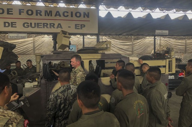 West Virginia Army National Guard (WVARNG) Master Sgt. Ricky Baker and Sgt. 1st Class Joshua Dunlap discuss preventative maintenance checks and services of the M1165 HMMWV Nov. 28, 2018, with Peruvian army maintenance personnel during a Subject Matter Expert Exchange (SMEE) Global Peace Operations Initiative (GPOI) mission held in Lima, Peru. The WVARNG helped to improve maintenance support for Peru's Training Center for Peace Operations upcoming mission to the Central African Republic and enhanced non-commissioned officer (NCO) development in their armed forces.