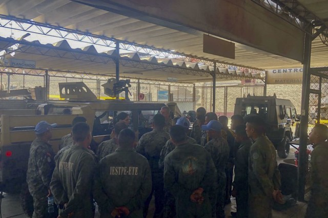 West Virginia Army National Guard (WVARNG) Sgt. 1st Class Joshua Dunlap discusses preventative maintenance checks and services of the M1165 HMMWV Nov. 28, 2018, with Peruvian army maintenance personnel during a Subject Matter Expert Exchange (SMEE) Global Peace Operations Initiative (GPOI) mission held in Lima, Peru. The WVARNG helped to improve maintenance support for Peru's Training Center for Peace Operations upcoming mission to the Central African Republic and enhanced non-commissioned officer (NCO) development in their armed forces.