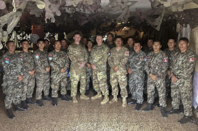 West Virginia Army National Guard (WVARNG) Master Sgt. Ricky Baker and Sgt. 1st Class Joshua Dunlap pose for a photo with members of the Peruvian army following the completion of a Subject Matter Expert Exchange (SMEE) Global Peace Operations Initiative (GPOI) mission held in Lima, Peru, Nov. 26 -- 30, 2018. The SMEE GPOI mission with the Peruvian army helped to improve maintenance support for Peru's Training Center for Peace Operations upcoming mission to the Central African Republic and enhanced non-commissioned officer (NCO) development in their armed forces.