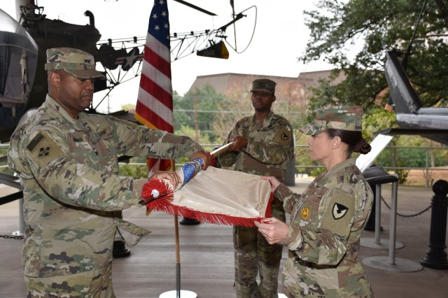 Col. Robert McDonald (left) and Command Sgt. Maj. Sol Nevarezberrios case the 410th Contracting Support Brigade colors during a ceremony Nov. 30 at Joint Base San Antonio-Fort Sam Houston, Texas, in preparation to deploy to Afghanistan in support of Operation Freedom's Sentinel. McDonald is the commander of the 410th CSB and Nevarezberrios is the brigade command sergeant major.