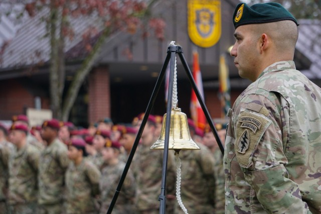 JOINT BASE LEWIS-MCCHORD, Washington- A 1st Special Forces Group (Airborne) Soldier stands ready to ring the bell for each of the names of the 1st SFG (A) Soldiers and their Canadian Special Forces partners who gave their lives during the Global War on Terrorism. The ceremony, held at the 1st SFG (A) headquarters, commemorates the deactivation of the First Special Service Force in Menton, France on Dec. 5, 1944 and honors those Special Forces Soldiers who have given the ultimate sacrifice. (U.S. Army photo by Sgt. 1st Class Christopher Harper)