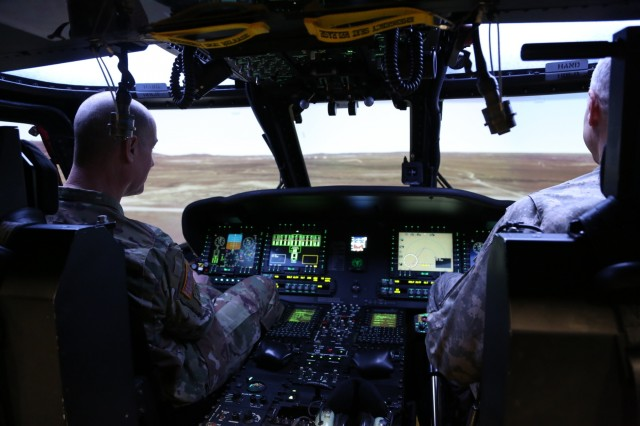 Command Sgt. Maj. Jon R. Stanley, U.S. Army Research, Development and Engineering Command's command sergeant major, is briefed on the Black Hawk Aircrew Trainer Oct. 25 during a tour of RDECOM Aviation & Missile Systems Simulation and Software Integration Directorate facilities at Redstone Arsenal, Ala.