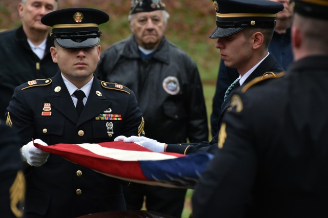 New York Army National Guard Soldiers in the Honor Guard fold the U.S. Flag during a funeral service for Pfc. John Martin in Schuylerville, N.Y., Dec. 2, 2018. Martin had gone missing in action during the Korean War at the battle of Chosin Reservoir. His family had finally received his body after 68 years as listed missing.