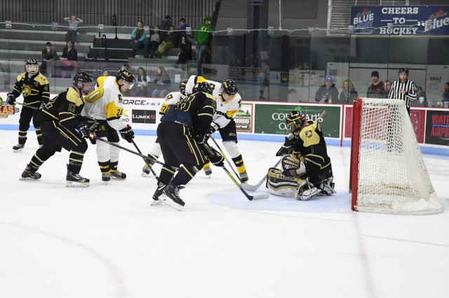 After three days of practice, the All Army Ice Hockey Team faced their first opponents Dec. 1 in a scrimmage against the West Point Club Hockey Team at the Watertown Municipal Arena. All Army won 12-2. (U.S. Army Photo by Mike Strasser, Fort Drum Garrison Public Affairs)